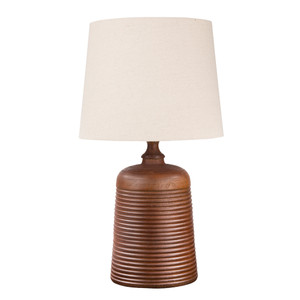 As Shown: Ripple Table Lamp Size: 13 diameter x 23 H inches Material: Cinnamon Cast Resin Shade: Linen  Description: The ripples of this elegant table lamp are formed from cast resin in cinnamon or bone hues. Fitted with a modified bell shade in natural linen, this lamp casts its rustic charm in your contemporary interior.