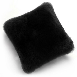 As Shown: Genuine Sheepskin Pillow Size: 14 x 14 inches Material: Black Sheepskin  Description: Tossing these naturally luxurious pillows of brushed New Zealand longwool sheepskin simply won't happen. You'll be too entranced by their soft cuddle to let them leave your side. A fabric back matches each of the four colors and six sizes.