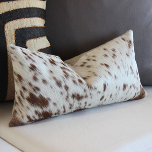 As Shown: Spot-on Hide Pillow Size: 9 x 18 inches Material: Cowhide Color: Brown Spotted