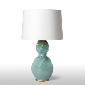 As Shown: Carrillo Table Lamp Size: 19 diameter x 31 H inches Material: Glazed Ceramic Shade: Silk  Description: Twisty, turny and entirely unique, this celadon glazed ceramic lamp with gold lined, bright white silk empire shade has heads spinning in its direction.