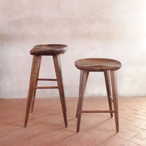 As Shown: High Ball Walnut Bar Stool Size: 16 x 13 x 24 H inches or 16 x 13 x 29 H inches Material: Solid Walnut   Description: Solid walnut with a satin finish, tapered legs and a carved seat put the high in highball. Counter or pub height, satin finished solid walnut, this stool shouts rustic chic while whispering contemporary style.