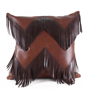 As Shown: Rodeo Fringe Pillow Size: 18 x 18 inches Material: Leather Color: Saddle Brown with Chocolate Brown Fringe  Description: Channel cowboy cool in a chevron pattern of contrasting leathers. Artisans piece and hand-trim the fringe front, then back with matching leather. Fitted with a feather and down inner and hidden zipper, your pillow will be individually created for you. With multiple size and color options, you can round up whatever look you choose: high-contrast, subtle tone-on-tone, or biker black.