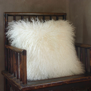 As Shown: Snowfall Mongolian Lamb Pillow Size: 16 x 16 inches  Description : You'll love to cozy up with this white Tibetan fur pillow. Its snowy purity injects lush texture when tossed into any interior. By hand, artisans craft these premium designer-quality lambskin cushions. Backed in matching fabric with a feather and down inner, your pillow will be individually created for you.