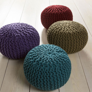 As Shown: Wool Sweater Pouf Size: 20 dia x 14 H inches Material: Wool in Brick Red, Olive, Purple or Teal  Description: Our happy, colorful poufs add a pop of saturated shade to your interior. They are densely packed with shredded cotton for a delightful extra seat or couchside support. Handmade in India of chunky knit wool, these poufs are like the comforting embrace of your favorite woolen sweater.