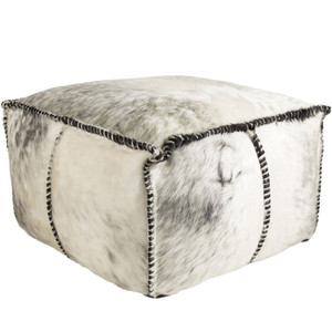 As Shown: Home On The Range Pouf - RRPF-001 Size: 22 x 22 x 13 H inches Material: Hair-On Cowhide  Description: Spontaneous seating makes an intentional impact on your home in this hair-on cowhide pouf handmade in India. The natural variation of the white with black cowhide is accented by the stitched edges on each quadrant. Filled with dense cotton, you'll never hear a discouraging word from this pouf.