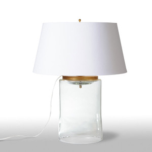 As Shown: Westport Table Lamp Size: 22 diameter x 28.5 H inches Material: Clear Mouth Blown Glass Shade: Silk Empire   Description: The can-do practicality of New England has been (mouth) blown to life in this sturdy Mason Jar-shaped glass lamp. The gold-leafed accents and gold-lined white silk empire shade elevate it to refined distinction without losing restraint or common sense.