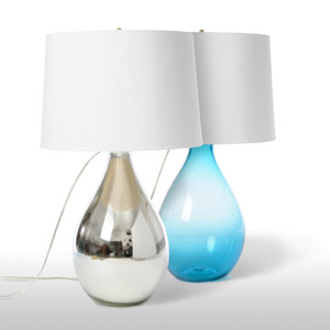 As Shown: Irving Park Table Lamp Size: 19 diameter x 37 H inches Material: Glass Color: Silver, Aqua Shade: Silk Shade Color: White  Description: Handmade by artisans in the USA of aqua or silver glass and topped with a gold-lined white silk deep empire shade, this lamp's craftsmanship stands on its own. Or in pairs of sparkling, luminescent teardrops.