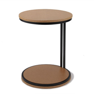 "As Shown: Discus Occasional Table Size: 18 diameter x 24 H inches Material: Sustainable Cork, Powdercoated Steel Finish: Natural Coarse Grain, Black Description: The steel frame of this table springs apart to grip the shoulder of the 1 1/2"" solid cork top and bottom. Discus Table is perfect for computers, coffee cups, and wine glasses, and for anything steaming hot, ice cold, hard, soft, moist, sharp, or fragile. It nestles to sofas, armchairs, and beds, and stands equally well on its own as a handsome sculptural element. The cork bottom makes the Discus Table slide easily on hard or carpeted floors."