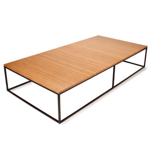 As Shown: Nimbus Bamboo Rectangular Coffee Table Size: 36 x 72 x 13.5 H inches Material: Sustainable Bamboo, Powdercoated Steel Finish: Caramelized, Black  Description: Nimbus means cloud, and this bamboo coffee table floats above its powder coated steel frame. Handmade to order in the USA from sustainable Moso bamboo, this table celebrates the strength and beauty of this fast-growing plant, which allows for minimal construction and timeless aesthetic. Choose from heights, bamboo colors and base finish.