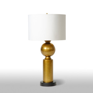 As Shown: Deco Brass Table Lamp Size: 15 diameter x 20 H inches Material: Plated Aluminum Shade: Silk Drum  Description: The bold, gold geometry of this lamp of brass-plated aluminum unites strict rectilinear with the sensual curve. Handmade by Indian artisans and topped with a gold lined white silk drum shade, this lamp transforms ordinary space into extraordinary, enviable design.