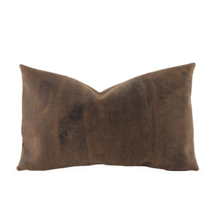 As Shown: Buffalo Leather Pillow Size: 12 x 20 inches Material: Leather Color: Distressed Brown  Description: A pillow with rugged toughness and tailored precision, you say? We say the Western Buffalo Leather Pillow is exclusive to Pfeifer Studio. The designer-quality distressed buffalo leather exterior features a removable feather and down inner for plush comfort. Handmade-to-order in India, choose from sizes and a backing in linen or leather.