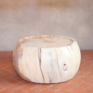 As Shown: Rebekah Cocktail Table Size: 30 diameter x 16 H inches Finish: White Wash Topcoat: Sealed Topcoat  Description: Inherently beautiful for the organic, solar-kiln aged cracks and separations that develop in the Ponderosa pine, this table is handmade-to-order in our New Mexico workshop by artisans whose skill is evident. From the naturally curving sides to the carved, recessed top surface, we start with wood harvested primarily in the mountains of Northern New Mexico. The result is a rustic statement piece to suit any décor.