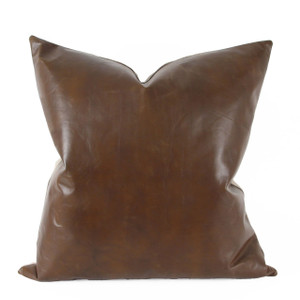 As Shown: Tobacco Brown Leather Pillow Size: 22 x 22 inches Material: Leather  Description: Smoky cool is king in toasted tobacco cowhide leather available in three styles for your customization. Toss it anywhere for neutral depth and character. Artisans finish the designer quality cowhide leather front per your specifications, then back in natural line or matching leather. Fitted with a feather and down inner and hidden zipper, your pillow will be individually created for you.