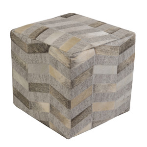As Shown: Silver Lake Cowhide Pouf - MDPF-001 Size: 18 x 18 x 18 H inches Material: Viscose, Hair-On Cowhide  Description: Like the waves of a silvery lake, individual strips form an undulating pattern on this hair-on cowhide pouf. By hand artisans seam a patchwork of hair-on cowhide over an upholstered body. Each is individual to you, please allow for variation in color and markings.