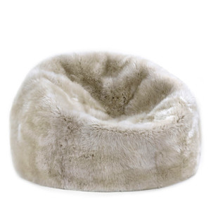 As Shown: Sheepskin Bean Bag Size: 36 dia inches Material: Sheepskin Wool in Linen  Description: Sink into our luxurious genuine sheepskin beanbag for the ultimate in modern sumptuousness. In your choice of rich tones, it is made by hand in New Zealand of genuine longwool sheepskin.