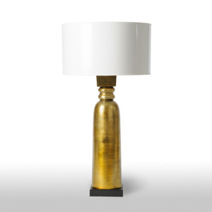 As Shown: Aged Gold Table Lamp Size: 19 x 19 x 38 H inches Material: Brass Finish on Aluminum Shade: Painted Parchment with Gold Liner  Description: Presence and beauty abound in a classic table lamp in aged gold. Flanking a chesterfield or lighting a study desk, this handmade piece imparts steadfast character.