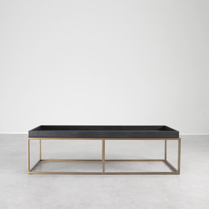 As Shown: Brentwood Leather and Brass Cocktail Table Size: 22 x 60 x 17 H inches Material: Steel with Brass Finish, Leather