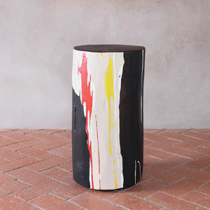 As Shown: Abstractionist Hand Painted Side Table Size: 12 dia x 20 H inches Color: Black, Beige, Orange, Yellow, Purple and Blue Topcoat: Sealed Topcoat  Description: Evoking power and urgency, rich and vibrant hues merge and separate to create an abstract painting on a solid wood log table, which varies and changes colors along the sides. Each table is an original work-of-art, intricately hand-painted by New Mexico artist, J Meyers. This blend of natural element and human creativity begins with a Ponderosa pine log harvested in Northern New Mexico. It is seasoned for months to enhance the natural cracks and separations found in sun-dried wood before being painted and sealed with a protective finish.