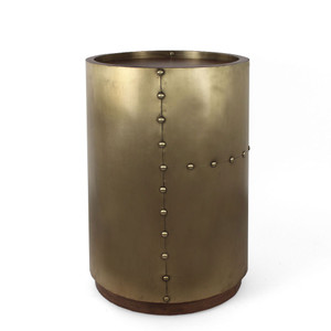 As Shown: Ocean Liner Side Table Size: 14 dia x 22.5 H inches Material: Brass, Wood  Description: Set your tumbler of whiskey down and be transported to an ocean liner at sea. Inject yacht chic into your next voyage – even if it's just from the sofa to the bar to refresh your drink. By hand artisans wrap riveted brass around a wooden frame, leaving exposed the porthole-round inset wooden top and recessed base. This piece is then finished with a wax topcoat in a satin sheen.
