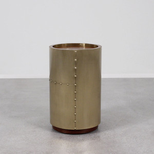 As Shown: Ocean Liner Side Table Size: 14 dia x 22.5 H inches Material: Brass, Wood