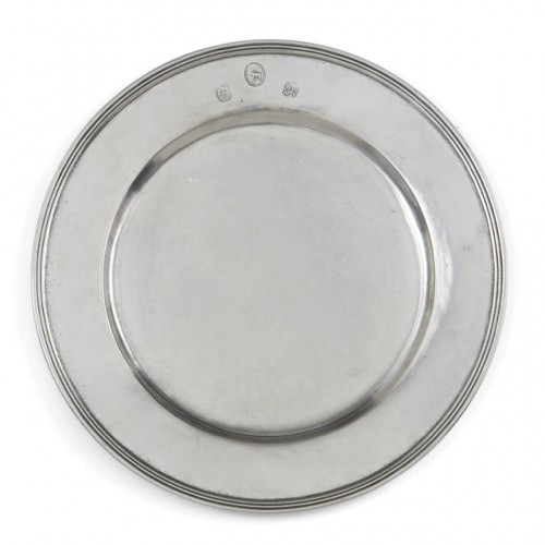 """Centuries-old technique and fine Italian pewter make a beautiful presentation. This charger moves from contemporary to traditional with ease. Italian pewter, Hand made in Italy.  Food safe, dishwasher safe on the low-heat/air-dry setting, non-abrasive detergent recommended.  Dimensions: 13"""" D SKU: P2473"""