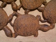 Dancing turtle plaque detial