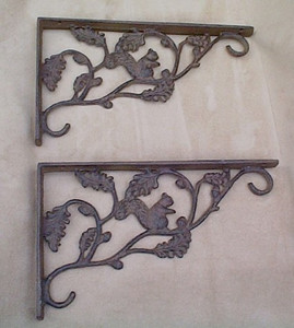 Squirrel shelf porch or door brackets ~ pair ~ cast iron