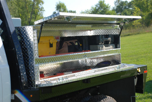 Topsider tool box with doors leaves plenty of room on the flatbed for hauling other equipment & supplies (tools shown not included)
