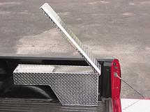 Opens up so you can access it from either inside or outside the truck