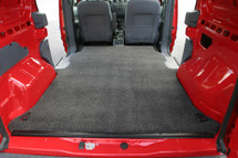 Covers cargo area behind front seats to rear doors.