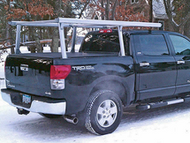 Aluminum Overhead Stake Pocket Truck Ladder Rack shown mounted with a tonneau cover - Standard Model