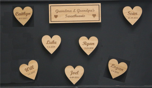 "Alder Refrigerator Magnets with a sign that says ""Grandma's Sweethearts"" and surrounding hearts with grandkids names and date of birth."