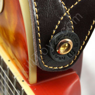 Black Guitar Strap Lock shown in use on an electric guitar. Helps secure your strap to your guitar.