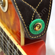 Green Guitar Strap Lock shown in use on an electric guitar. Helps secure your strap to your guitar.