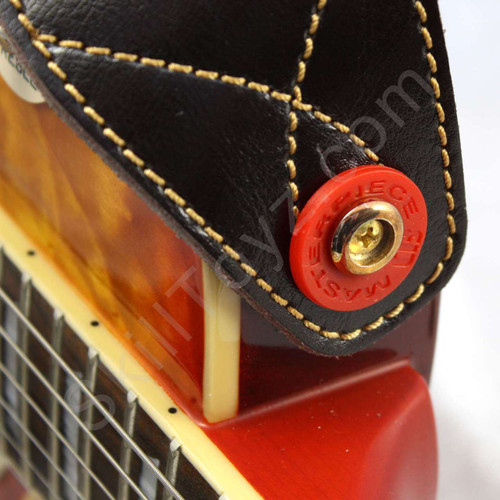 Red Guitar Strap Lock shown in use on an electric guitar. Helps secure your strap to your guitar.