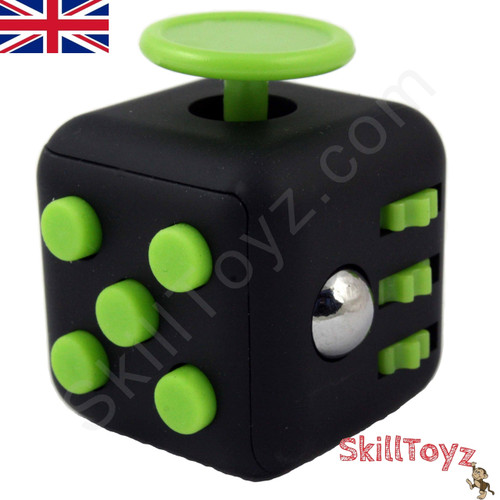 Premium Edition Fidget Cube featuring a larger body and soft touch rubberised finish. Black and green