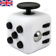 Premium Edition Fidget Cube featuring a larger body and soft touch rubberised finish. White and black.