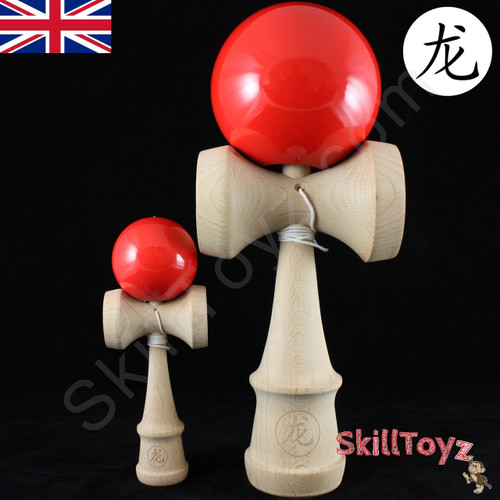 Dragon Colossus Giant Sized Wooden Kendama next to a standard competition sized kendama.
