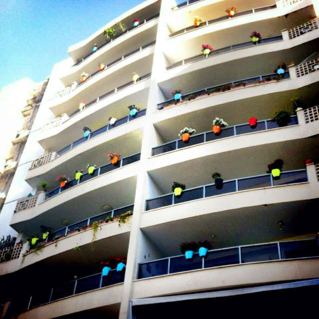Greenbo railing planters on buildings.