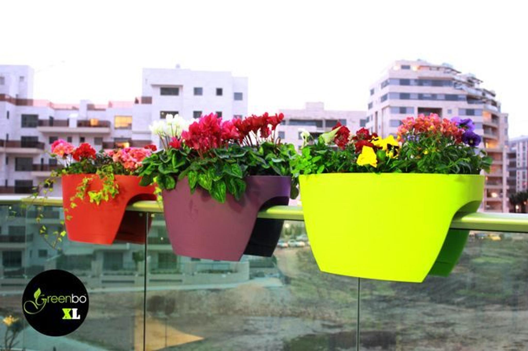 Extra large Greenbo railing planter on balcony.