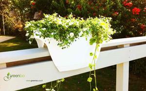 White extra large Greenbo planter on wooden railing.