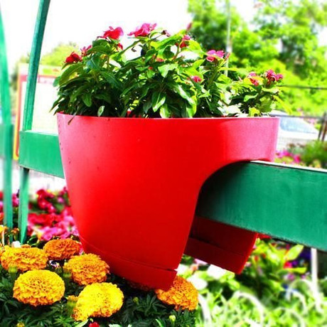 Extra large Greenbo railing planter on wooden fence.