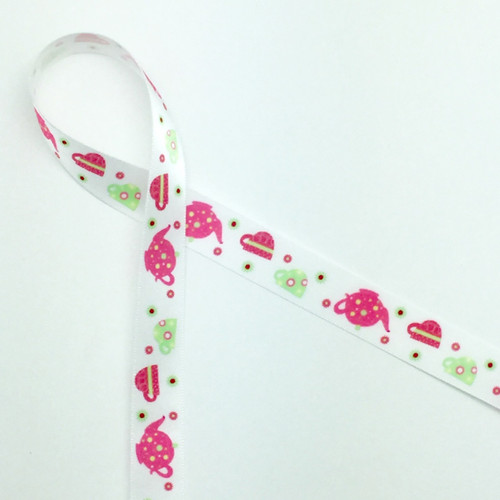 """Tea pots and tea cups are featured  in pink and green on a 5/8"""" white single face satin ribbon. Treat Mom to some spiced tea and cookies tied with this sweet ribbon to capture her heart on Mother's Day!"""