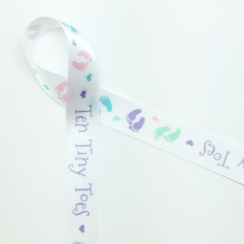 "Ten tiny toes along with pastel footprints on 5/8"" White Single Face Satin Ribbon"