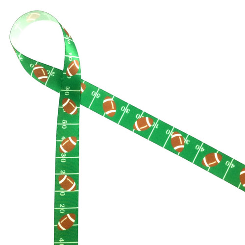 Footballs tossed along the green gridiron will make the perfect tie on your favors at your next football themed party!
