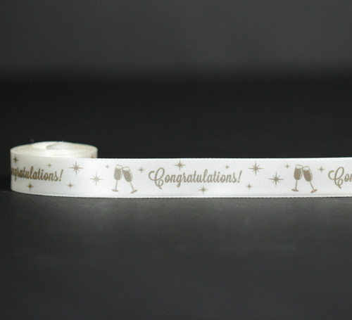 """Congratulations in gold with champagne glasses with stars on 5/8"""" antique white satin ribbon, 10 yards"""