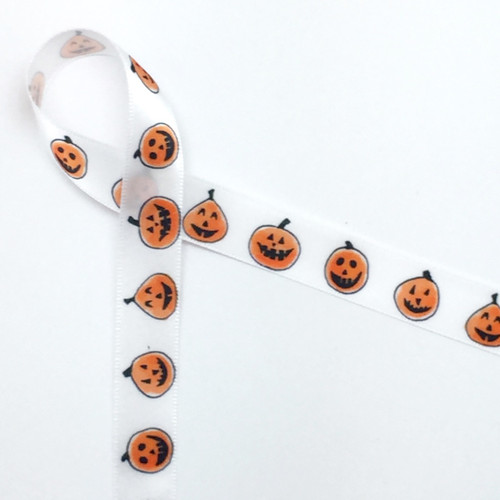 """Pumpkin cuties in a row smiling and having fun on 5/8"""" single face satin White ribbon, 10 Yards"""