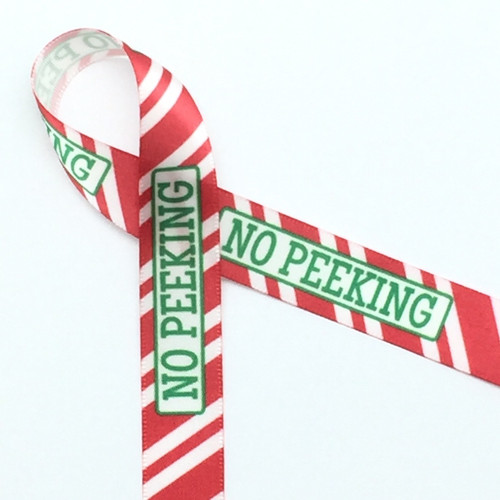 "No Peeking! This fun ribbon is printed with green text on red and white stripes on 5/8"" white single face satin. Make your small boxes much more interesting with this ribbon!"