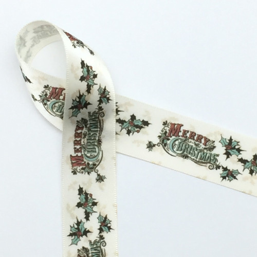 """Our vintage Merry Christmas featuring holly leaves in green with red berries on 7/8"""" Antique White single face satin ribbon brings back the time of Christmas past. Make your gifts memorable with this lovely vintage accent ribbon!"""