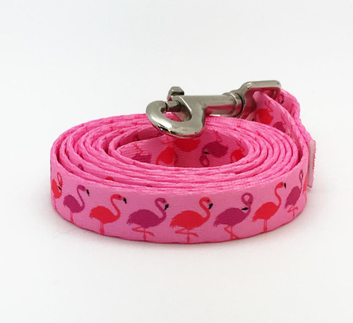 """Our 5/8"""" wide dog leash with pink and lavender flamingos on pink webbing is the perfect addition to your pup's tropical wardrobe!"""